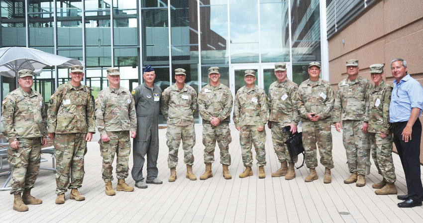 A group of men and women in the National Guard gather outside of the National Renewable Energy Laboratory (NREL) in Golden. The facility tour was one of the experiences part of the National Guard Arctic Interest Council's annual conference, which took place June 25-27.
