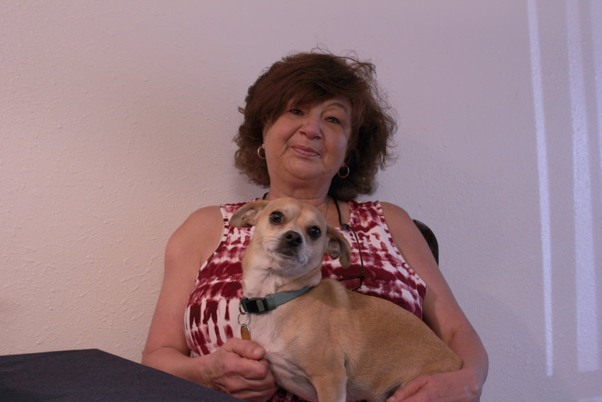 Deanie Labriola sits in her Arvada home with her dog, Charlie. Larbiola was formerly homeless for 20 years, and recently moved to an apartment in Arvada.
