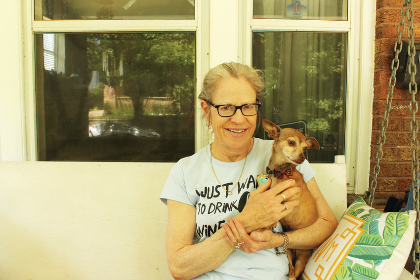 Beverly Bravo on the front porch of her Washington Park home with her dog Guido. Although Bravo has been using Airbnb for the last several years she decided it was too much work for too little money.