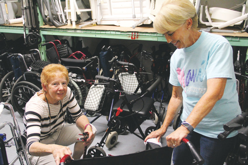 Donna Ralston, left, founder of the South Metro Medical Equipment Loan Closet, cleans a piece of equipment alongside volunteer Vicki Griffith July 3 at the nonprofit's location just outside central Centennial. The organization offers three-month loans — for free — of items such as wheelchairs, hospital beds, commodes and other equipment to help people recover from surgery or assist people in need of caretaking.