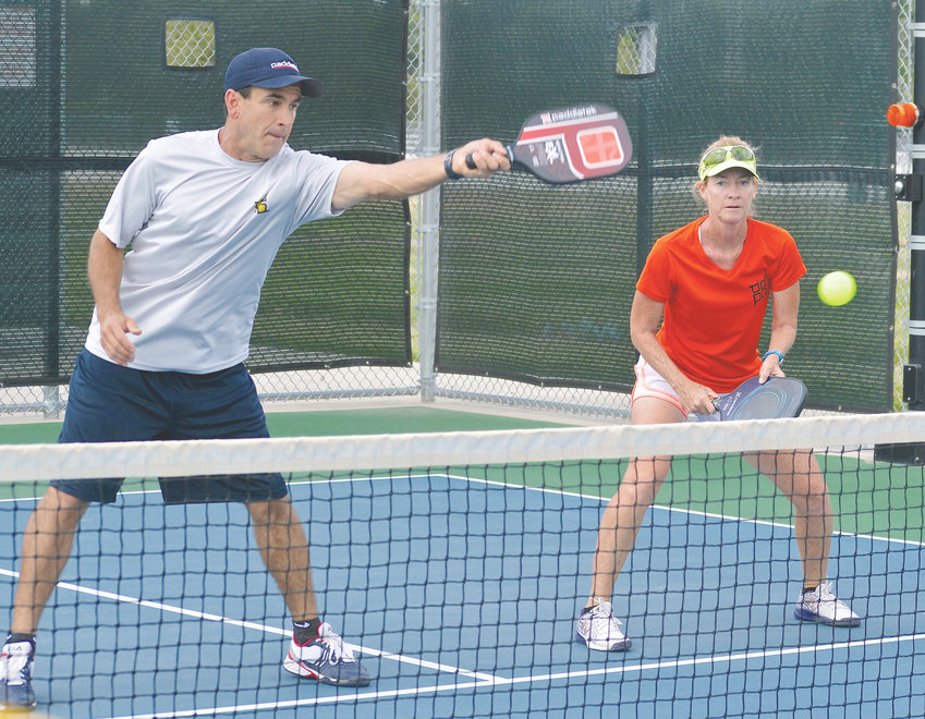 "Donnie Gallegos and his wife Patty are mixed-doubles players who compete in many of the local and regional pickleball tournaments. Donnie said pickleball can be competitive. ""You have beginners and then you get super-serious and super-competitive players like any other sport,"" he said."