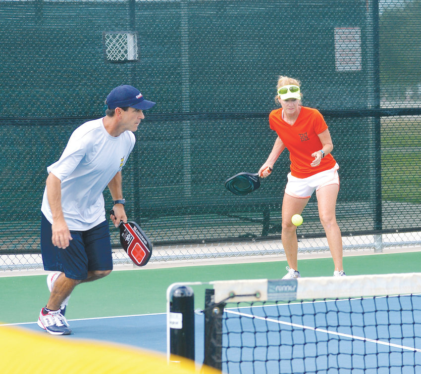 "Donnie Gallegos and his wife Patty, mixed-doubles players , compete in pickleball during a recent game. ""We started playing and we got addicted to it,"" Patty Gallegos said of pickleball."