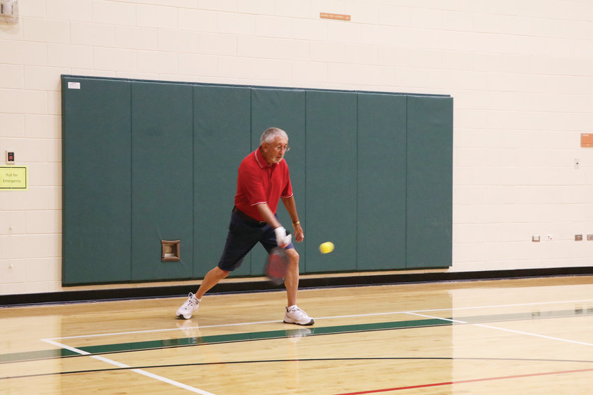 George Wiggins serves during a July 25 pickleball game at Malley Senior Recreation Center. The game is played by all ages and is reported to be the fastest growing game in the country.