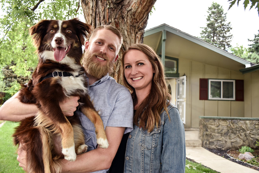 Ashley, Dustin and Hops Sever in front of their new house in Lakewood.