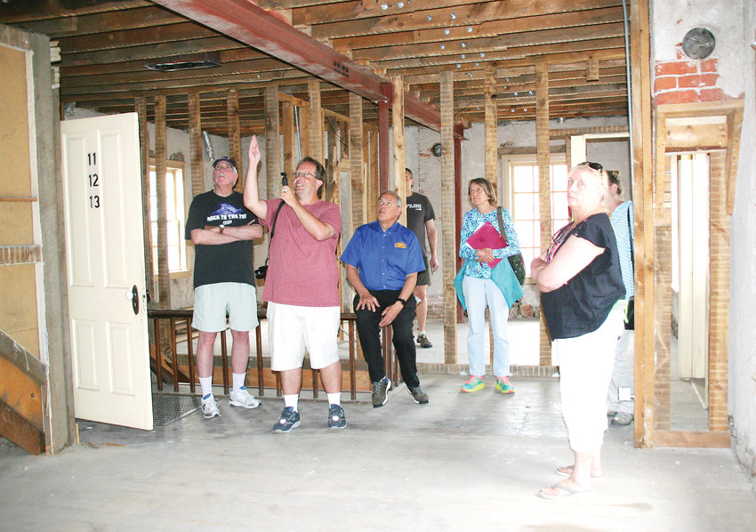 Local historian Rick Gardner, second from left, points out some of the Astor House's significant interior elements during a tour on July 1, which was attended by five members of the Golden Landmarks Association and one member of Golden's Historic Preservation Board.