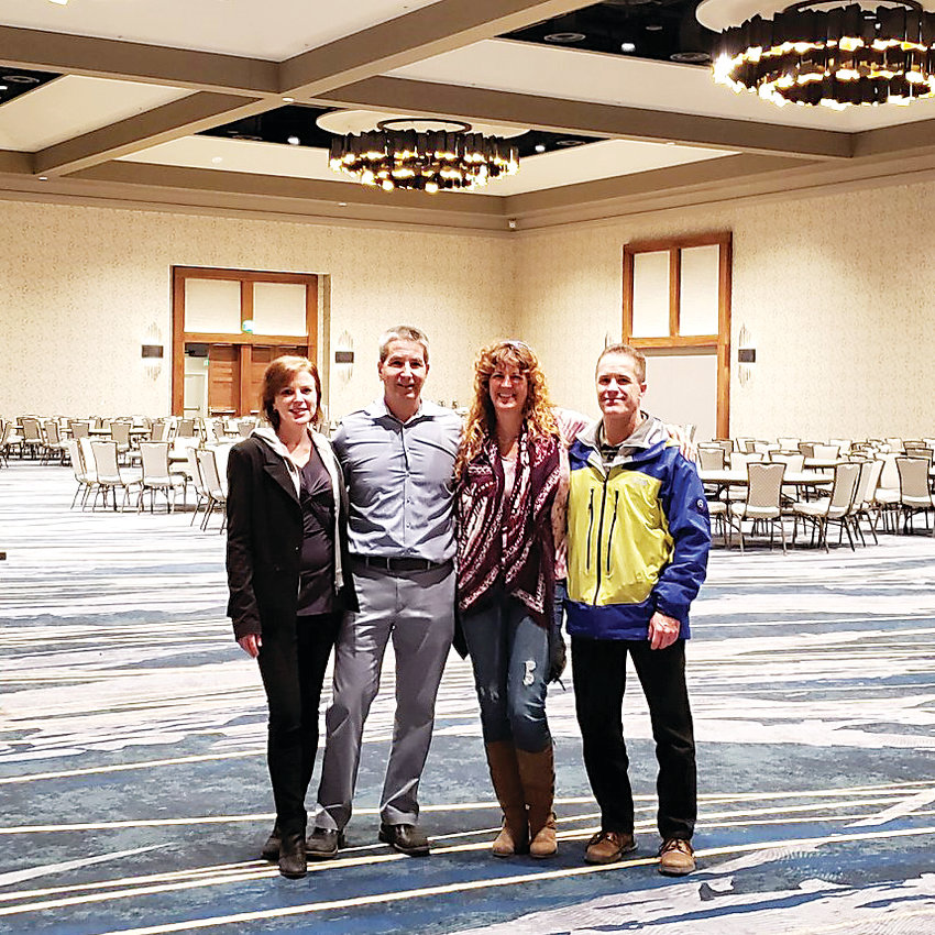 Jeff Gerber, second from left, and Kimberly Spomer, second from right, help plan the Low Carb Denver conference, organized by Denver's Diet Doctor and Dr. Rod Tayler.