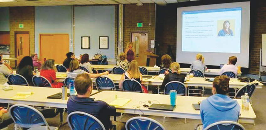 Mary Landerholm, an action plan manager for the Laboratory to Combat Human Trafficking, conducts a training session about identifying human trafficking July 2017 at the Community Reach Center site in Northglenn, Colorado.