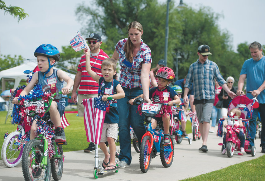 Young participants and their parents pedal the short course during Northglenn's Pedals and Paws event, part of the city's annual 4th of July celebration, at E. B. Rains, Jr. Memorial Park.