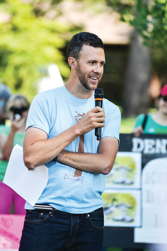 Justin Marceau, law professor at the University of Denver with a specialty in animal law, speaks to the protesters in Washington Park, Saturday morning July 6, 2019.