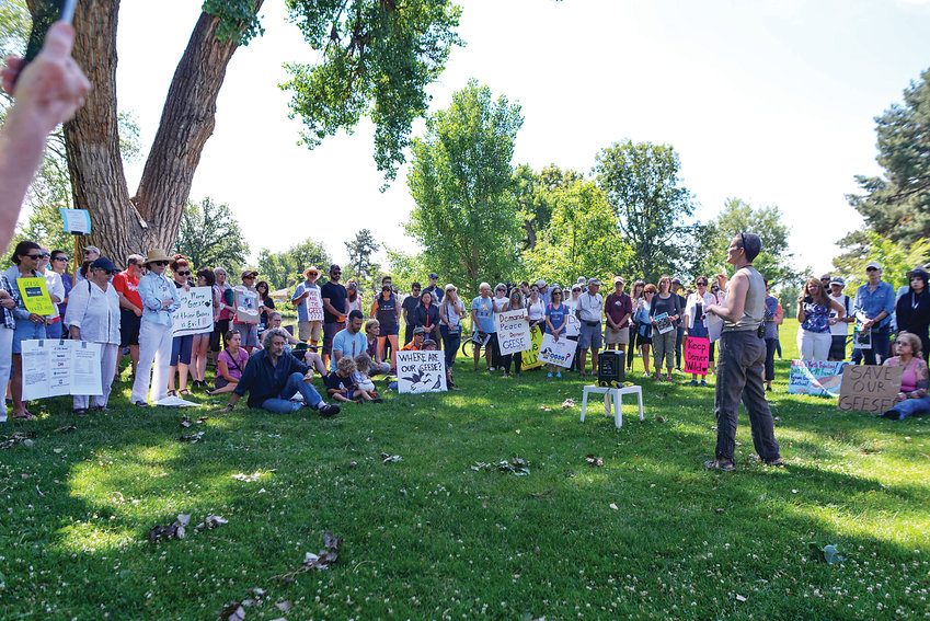 Canada Geese Protection Denver organizer Carole Woodall addressees the group of protesters gathered in Washington Park Saturday morning July 6, 2019.