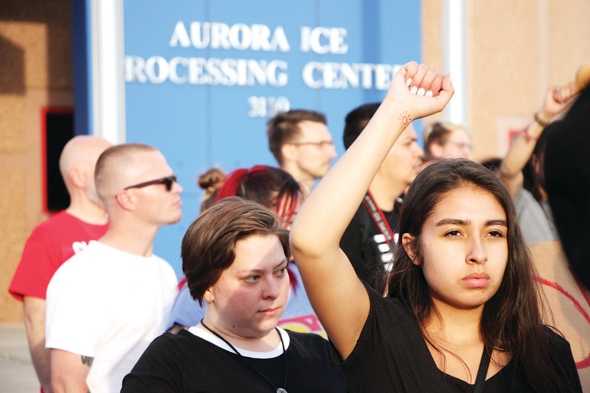 Protesters gather outside the GEO Group immigrant detention facility in Aurora.