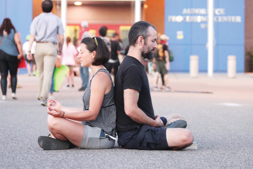 Protesters meditate outside Aurora's immigrant detention center.