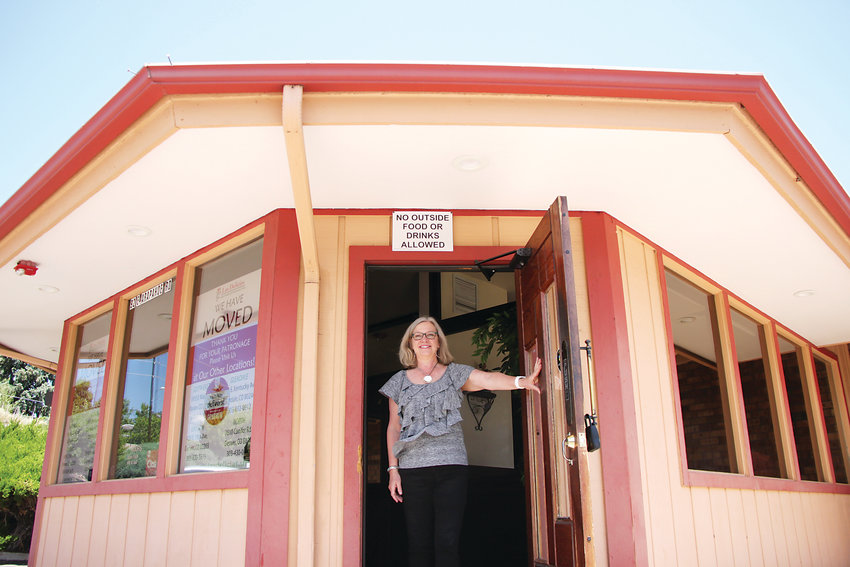 TLC Meals on Wheels executive director Diane McClymonds stands at the entrance of the group's new home, which until early July was beloved Mexican eatery Las Delicias.