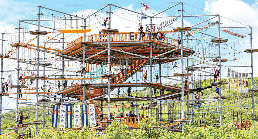 A crowd enjoys Castle Rock Adventure Park's newest attraction, the 50-foot high Sky Trek, which features 120 different obstacles.