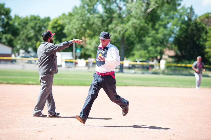 "Mike ""Texas"" Mikel, runs to third base in a vintage baseball game between Star Baseball Club of Colorado Territory and the Lightning Bolts of Westminster, on Saturday, July 13, at Wolff Run Baseball Park."