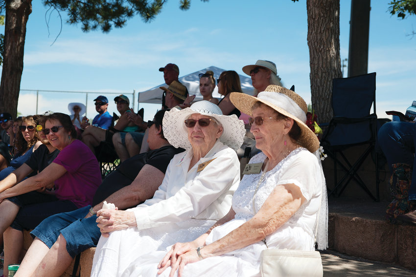 Illa Mae Immroth, left, and Bobbie Lowe, Trustees Emeriti of the Westminster Historical Society, take in the vintage base ball game between the Star Base Ball Club of Colorado Territory, and the Lightning Bolts of Westminster, at Wolff Run Baseball Park July 13.