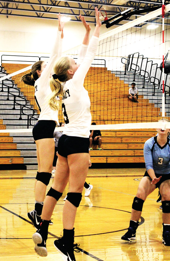 Against Mountain Range September 2018, Legacy's upcoming senior and junior Hope Hagara and Madison Crow attempt to make the block at the net.