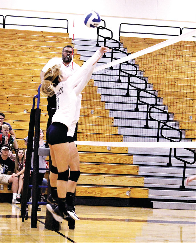 Then-Legacy sophomore Madison Crow makes the block in 2018 against Mountain Range.