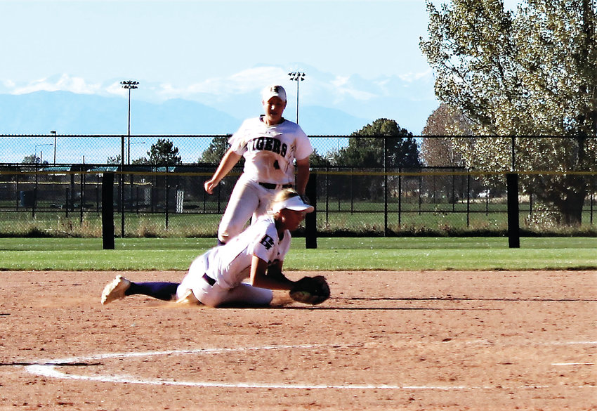 Junior Noelle Gardon makes the diving catch to clinch the 4A state title against Mountain View Oct. 20. Gardon will be among the team's seniors taking the field this fall.