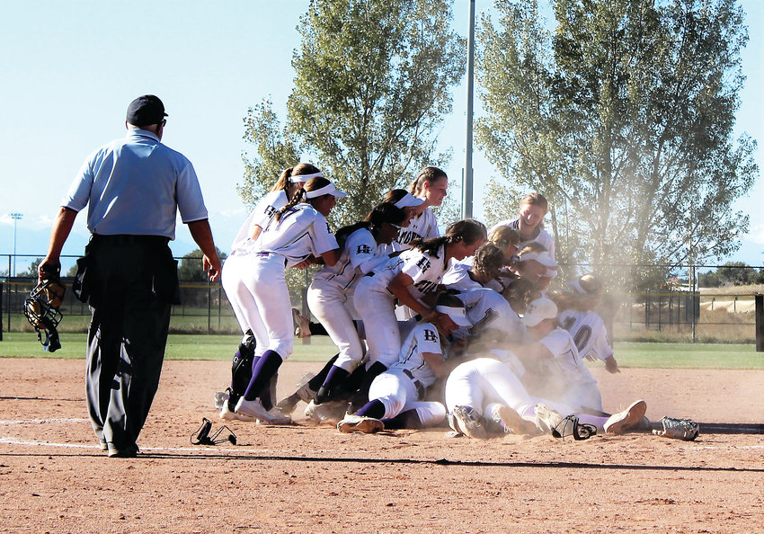 Holy Family softball celebrates winning the 4A state title Oct. 20 against Mountain View.