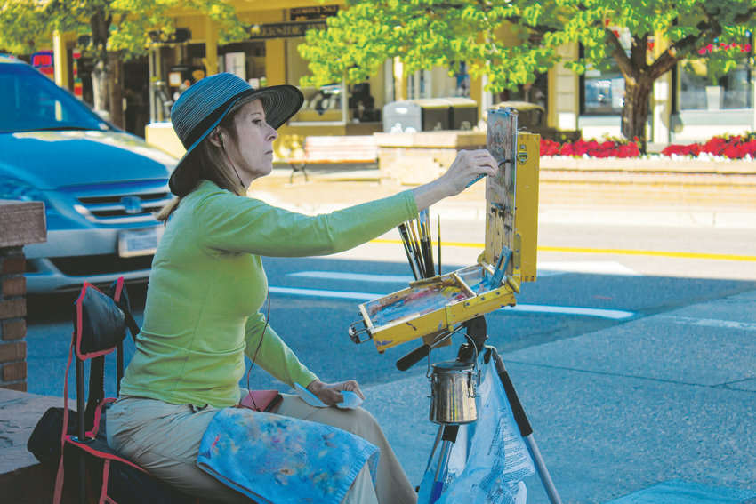 Susan Jerecky works on a painting in downtown Golden during ARTSWEEK GOLDEN's Plein Air Event on July 7, which was hosted by Foothills Art Center's Open Studio Group.