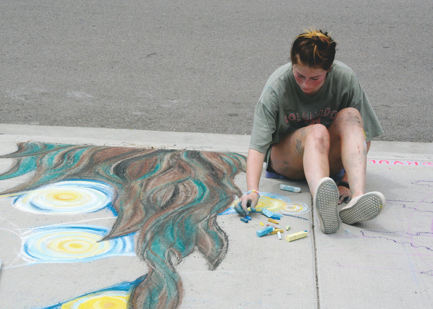 "Taylor Cramer of Monument works on her chalk version of Van Gogh's ""Starry Night"" during ARTSWEEK GOLDEN's Chalk on the Creek on July 12. Cramer's grandparents live in Golden, and last year, she participated in the chalk art event as a member of the public, so this year, ARTSWEEK GOLDEN's organizers invited her back to work alongside the professional artists as an aspiring artist."