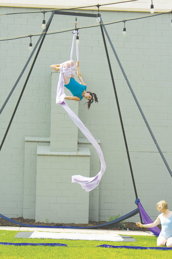 An acrobatic dancer with Apex Aerialists performs during the second annual Plein Air Event Exhibit on July 11 in the courtyard at Foothills Art Center, 809 15th St., in Golden.