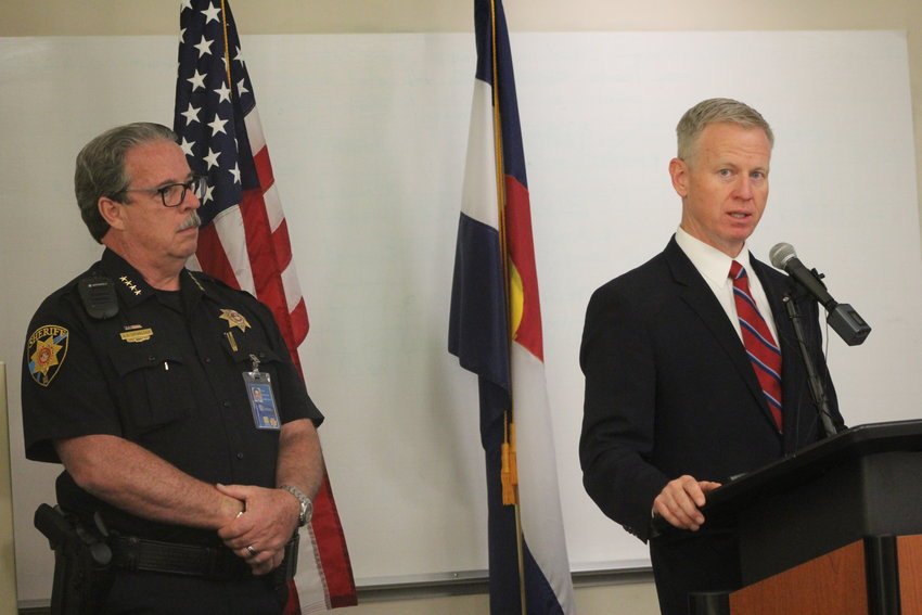 "Eighteenth Judicial District Attorney George Brauchler addresses the media during a July 17 press conference at the Douglas County Sheriff's Office substation in Highlands Ranch, accompanied by Sheriff Tony Spurlock. ""When someone is involved with someone on a bike, whatever fear sets in, you cannot make it better by fleeing,"" Brauchler said. ""You must stay and own up to the conduct and be there. That is humanity. That is who we are as Coloradans."""