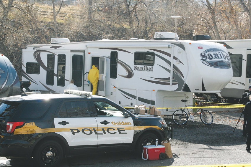 Investigators enter the RV trailer on Oct. 31 where Mitchell Bradford Ingle, 63, was discovered deceased after a welfare check was requested by the Salt Lake City Police, following a shooting they are investigating that happened on Oct. 30 on the University of Utah campus.