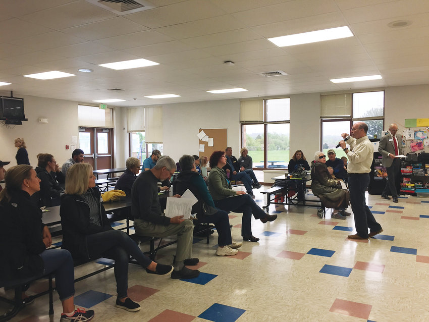John Anderson, second from right, speaks to community members and parents of area students at a meeting organized by the IAF.