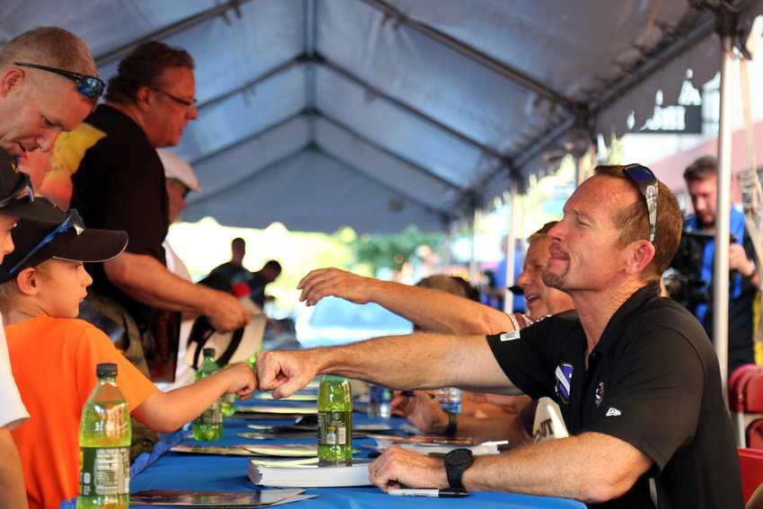 Funny car racer Jack Beckman sings autographs and meets fans at the MOPAR Block Party July 18.