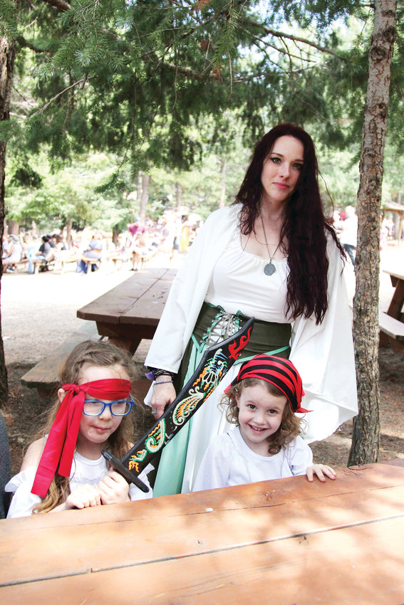 Sarah Periat has attended the Renaissance Festival since her childhood and now brings her family to the event. She sewed her costume.
