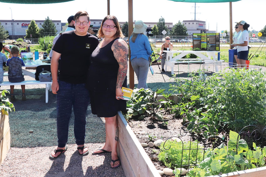 "Wheat Ridge resident Deborah Kerr and her son, James, have been a part of the Sunshine Community Garden for two years. Given the difficulties of gardening at home, ""I wouldn't be able to do a garden if it weren't for this community garden,"" she said."