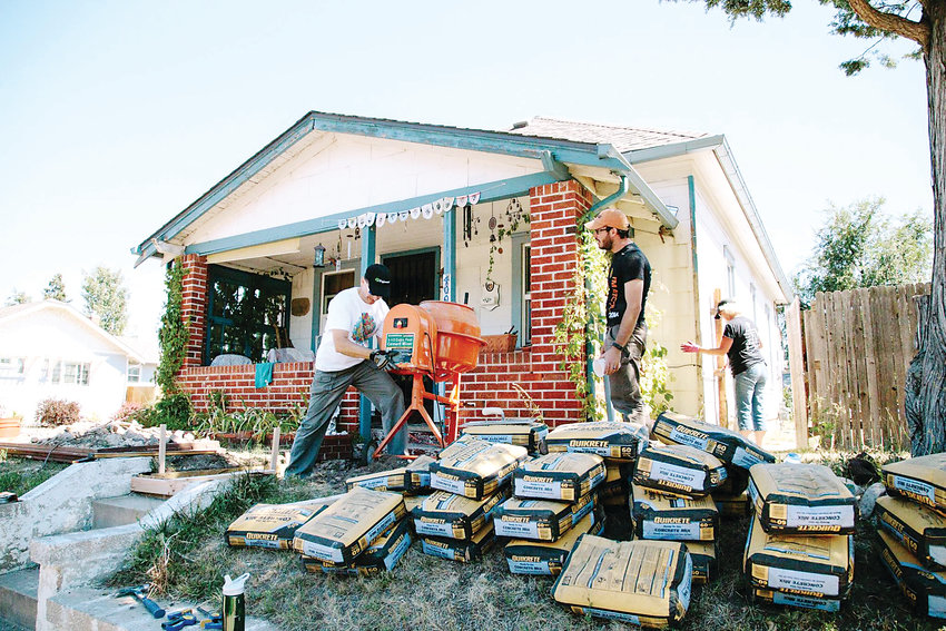 A few volunteers work on a home in Englewood during a previous year's Neighborhood Rehab Project's annual Be-A-Tool Day of Service. This year, the Day of Service takes place on Sept. 7, and registration for volunteers opens on July 28.