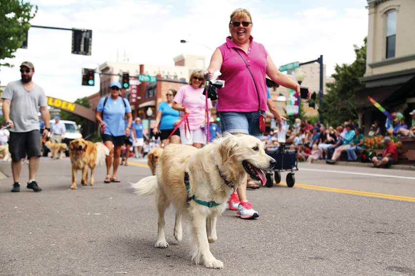 Dogs from Golden Retriever Rescue of the Rockies joined the parade July 27.