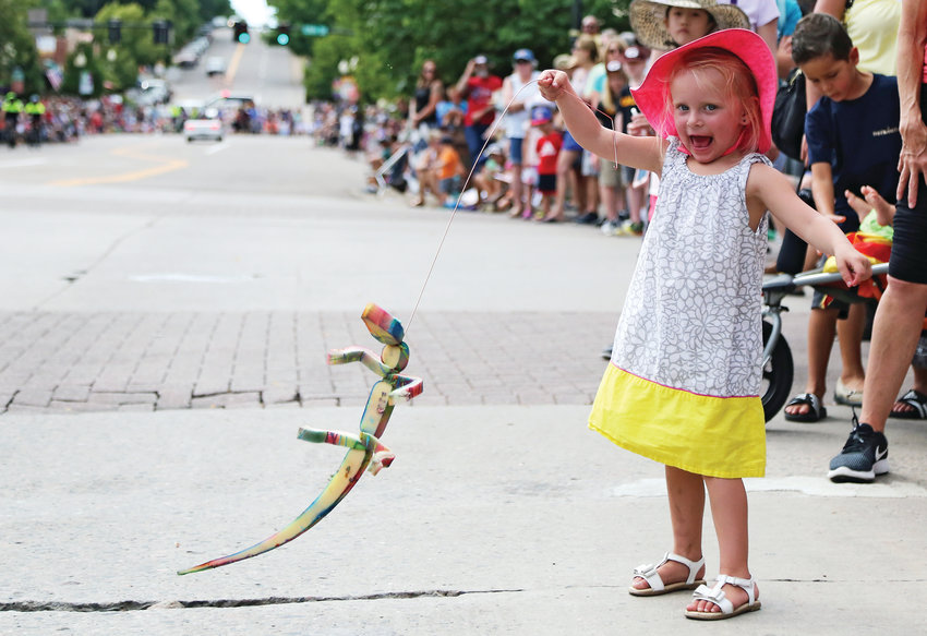Clary Doug, 3, plays with her new foam lizard at Buffalo Bill Days.