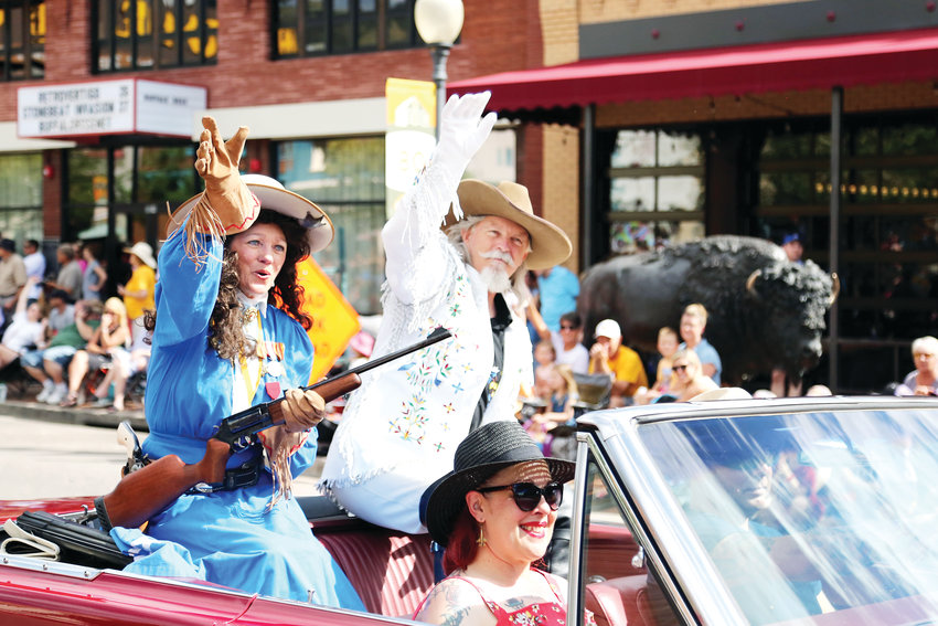 Annie Oakley and Buffalo Bill impersonators ride in the Buffalo Bill Day Parade held July 27.