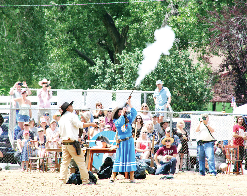 Annie Oakley, aka Little Sure Shot, uses her rifle to shoot balloons during Monarch Productions' Cody's Wild West, an annual attraction of Buffalo Bill Days which took place this year July 25-28.