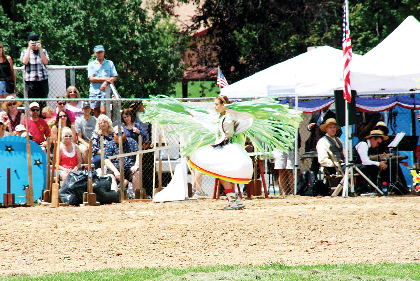 A Native American dancer performs during Monarch Productions' Cody's Wild West on July 27 during this year's Buffalo Bill Days celebration.