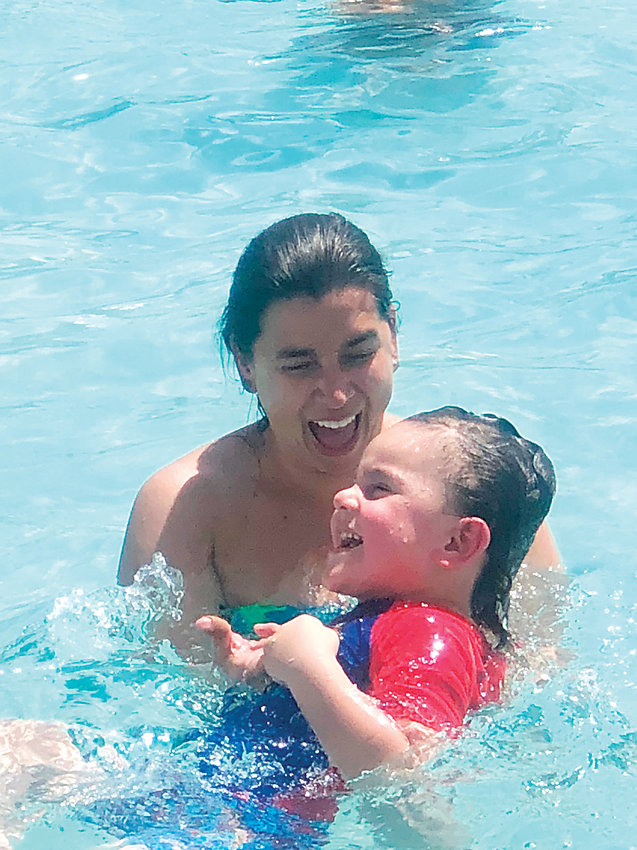 Three-year-old Bubba plays in the pool. He suffers from autism, but is making progress thanks to Firefly Autism, according to his grandmother, Nicole Taylor.