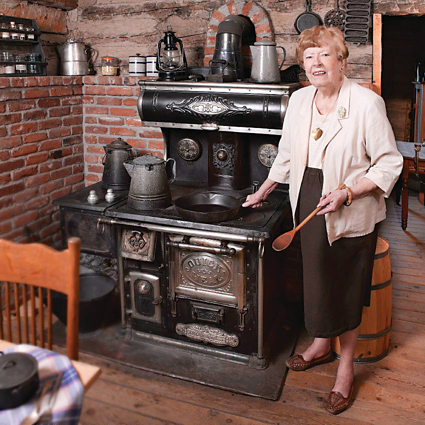 Irma Wyhs stands inside the Pearce Cabin at Golden History Park. Wyhs died at age 90 on June 20. She was a journalist and historian, and led the efforts to get the historic cabins to the history park in the late 1990s.