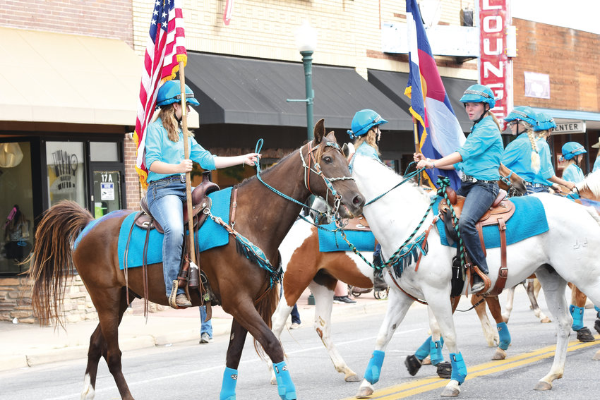 Equestrian riders representing Promenade Horsemanship Academy of Brighton, perform during the annual Adams County Fair Parade on July 27, in downtown Brighton.