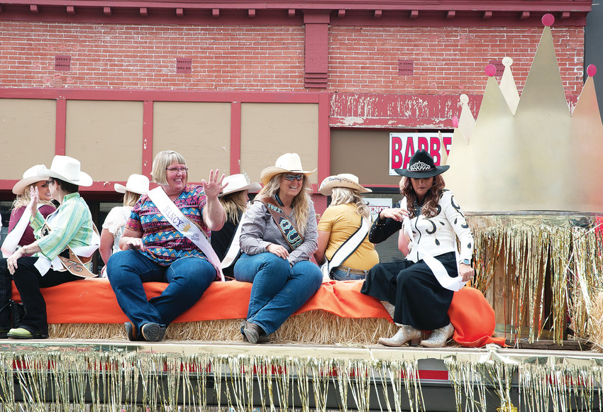 The official Adams County Fair parade float carrying Nancy Bunjes, and sister Alyssa Bunjes Baker, both former Adams County Fair Queens from 1980 and 1992, makes its way  through downtown Brighton July 27.