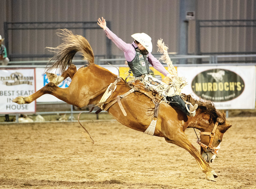 Chase Brooks, of Deer Lodge, Montana, catches some air during the saddle bronc riding event Aug. 2  at the Douglas County Fair & Rodeo.