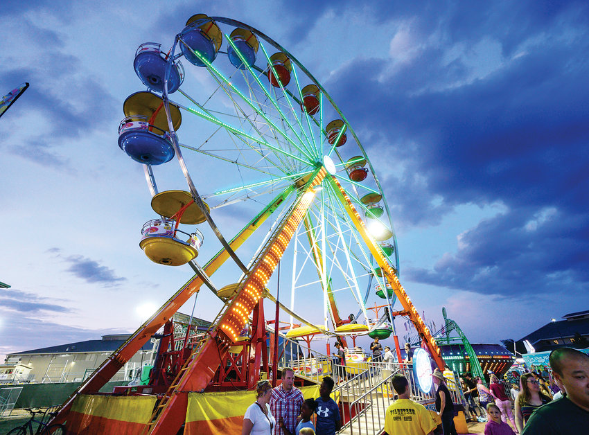 Night falls on the carnival at the Douglas County Fair and Rodeo.