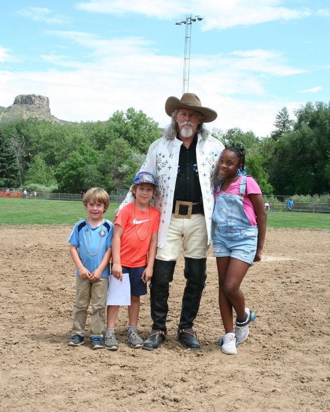 Goldenites Jude Lev, 6, and Zeke Lev, 7, have their photo taken with Buffalo Bill and his granddaughter Asyria Mullett, 10. Lance Michels performed as Buffalo Bill for Monarch Productions' Cody's Wild West during this year's Buffalo Bill Days. He and Mullett traveled from Saint Croix to attend this year's festival.