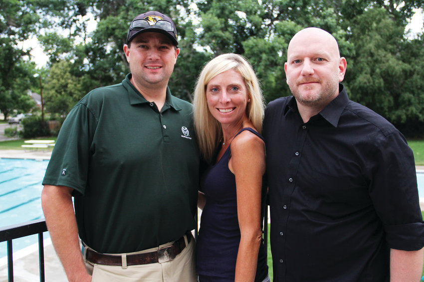 From left, Luke Ouellette, Katie Hess and her husband, Scott Hess, stand at the pool house Aug. 1 at the Cherry Hills neighborhood pool in Centennial. Ouellette and Hess are co-chairs of the social aspect of the Cherry Knolls Swim Club Board.
