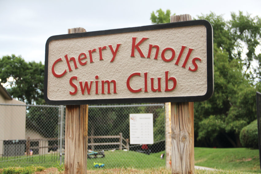A sign at the entrance of the Cherry Knolls pool at 3601 E. Costilla Place in Centennial. The pool club is at the center of many social functions in the neighborhood.