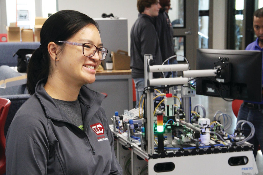 Jocelyn Nguyen-Reed, an information technology teacher, smiles while talking about the IT and STEAM — science, technology, engineering, art and math — program at Cherry Creek Innovation Campus. A former computer science teacher at Cherry Creek High School and a graduate of Overland High School, Nguyen-Reed helped shape the vision for the campus.