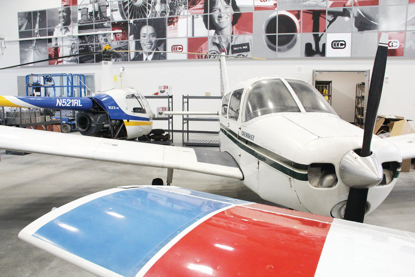 Planes and a helicopter sit at the Cherry Creek Innovation Campus, where students will perform maintenance work on the aircraft as part of the aviation maintenance program, one of many they can take at the new campus.